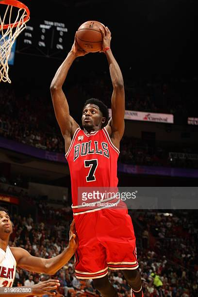 Justin Holiday of the Chicago Bulls dunks against the Miami Heat on April 7 2016 at AmericanAirlines Arena in Miami Florida NOTE TO USER User...