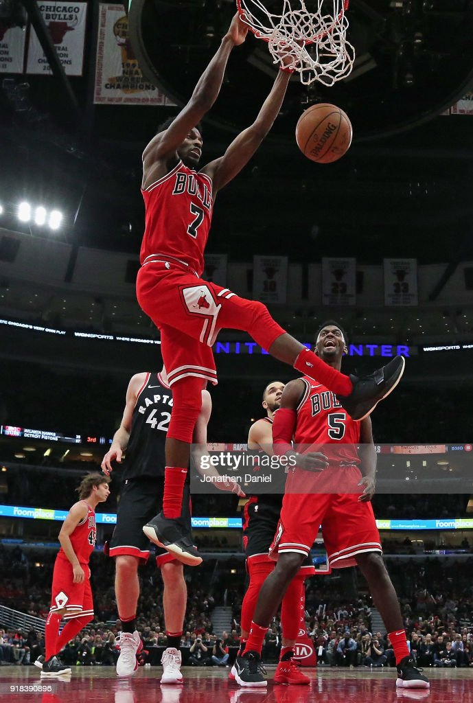Justin Holiday #7 of the Chicago Bulls dunks against the Toronto Raptors at the United Center on February 14, 2018 in Chicago, Illinois. The Raptors defeated the Bulls 122-98.