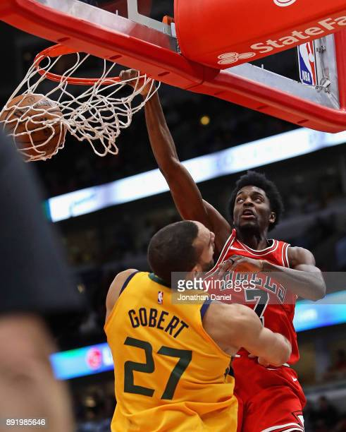 Justin Holiday of the Chicago Bulls dunks over Rudy Gobert of the Utah Jazz at the United Center on December 13 2017 in Chicago Illinois NOTE TO USER...