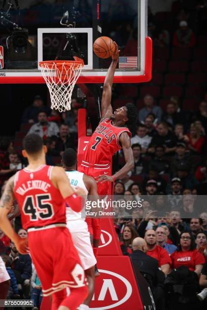 Justin Holiday of the Chicago Bulls dunks the ball against the Charlotte Hornets on November 17 2017 at the United Center in Chicago Illinois NOTE TO...