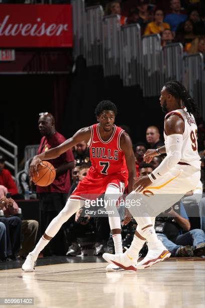 Justin Holiday of the Chicago Bulls handles the ball against the Cleveland Cavaliers during a preseason game on October 10 2017 at Quicken Loans...