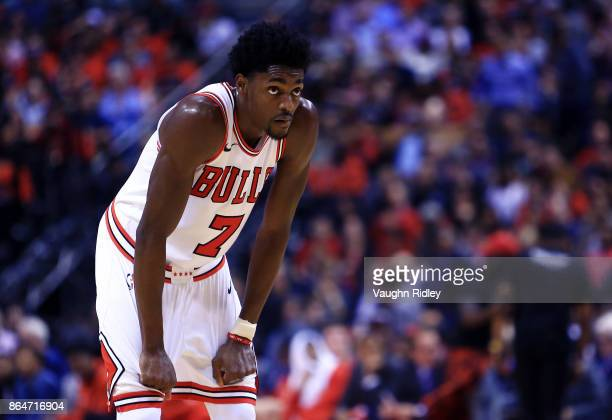 Justin Holiday of the Chicago Bulls looks on during to the first half of an NBA game against the Toronto Raptors at Air Canada Centre on October 19...