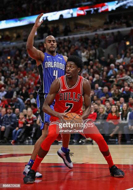 Justin Holiday of the Chicago Bulls moves against Arron Afflalo of the Orlando Magic at the United Center on December 20 2017 in Chicago Illinois The...