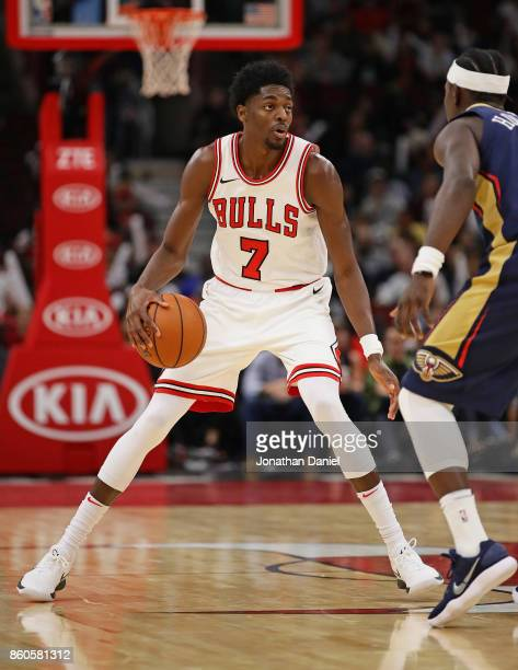 Justin Holiday of the Chicago Bulls moves against Jrue Holiday of the New Orleans Pelicans during a preseason game at the United Center on October 8...