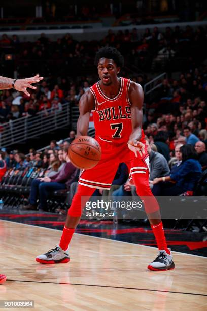 Justin Holiday of the Chicago Bulls passes the ball during the game against the Toronto Raptors on January 3 2018 at the United Center in Chicago...