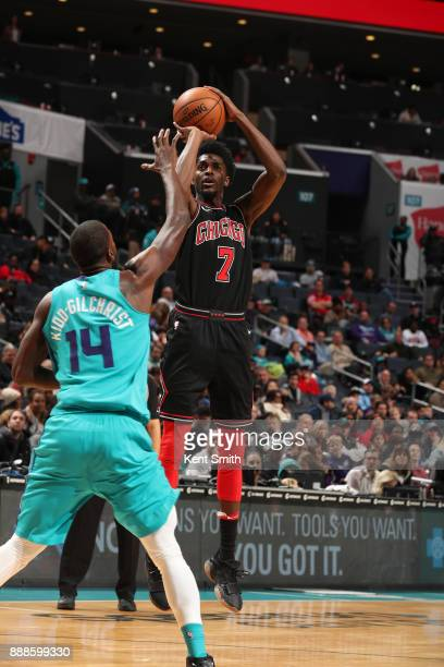 Justin Holiday of the Chicago Bulls shoots the ball against the Charlotte Hornets on December 8 2017 at Spectrum Center in Charlotte North Carolina...