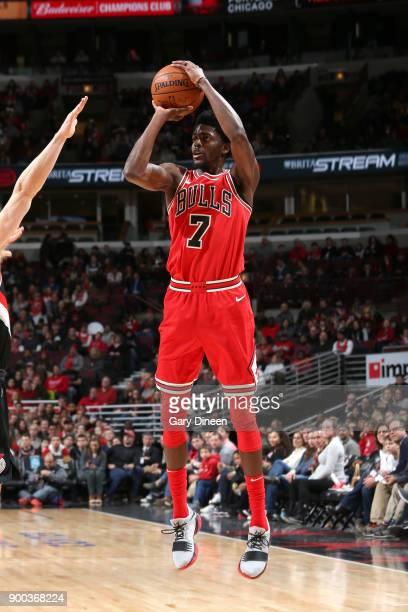 Justin Holiday of the Chicago Bulls shoots the ball against the Portland Trail Blazers on January 1 2018 at the United Center in Chicago Illinois...
