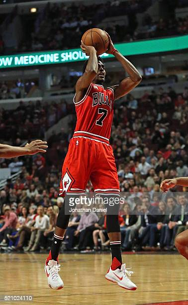 Justin Holiday of the Chicago Bulls shootsagainst the Philadelphia 76ers at the United Center on April 13 2016 in Chicago Illinois The Bulls defeated...