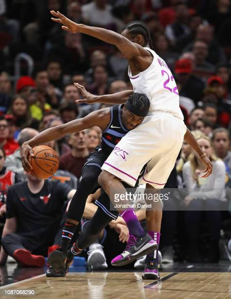 Justin Holiday of the Chicago Bulls tries to move against Andrew Wiggins of the Minnesota Timberwolves at the United Center on December 26 2018 in...