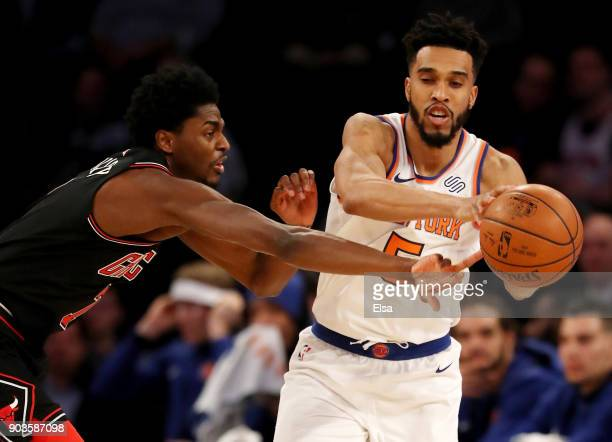 Justin Holiday of the Chicago Bulls tries to steal the ball from Courtney Lee of the New York Knicks in the first half at Madison Square Garden on...