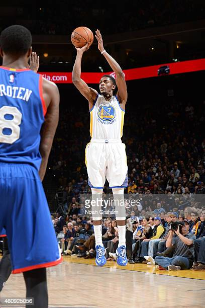 Justin Holiday of the Golden State Warriors shoots against the Philadelphia 76ers during the game on December 30 2014 at Oracle Arena in Oakland...