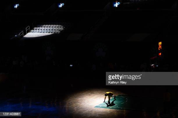 Justin Holiday of the Indiana Pacers stretches prior to the start of the game against the Boston Celtics at TD Garden on February 26, 2021 in Boston,...