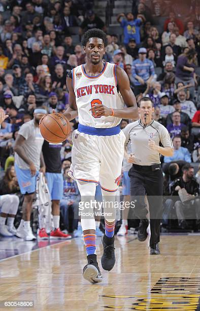 Justin Holiday of the New York Knicks brings the ball up the court against the Sacramento Kings on December 9 2016 at Golden 1 Center in Sacramento...