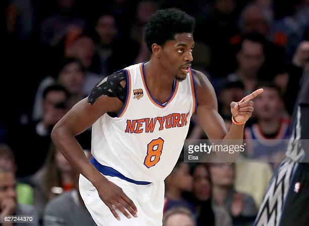 Justin Holiday of the New York Knicks celebrates his three point shot in the first half against the Minnesota Timberwolves at Madison Square Garden...