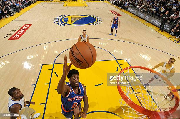 Justin Holiday of the New York Knicks goes to the basket against the Golden State Warriors on December 15 2016 at ORACLE Arena in Oakland California...