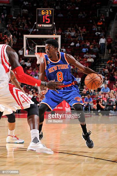 Justin Holiday of the New York Knicks handles the ball against the Houston Rockets during a preseason game on October 4 2016 at the Toyota Center in...