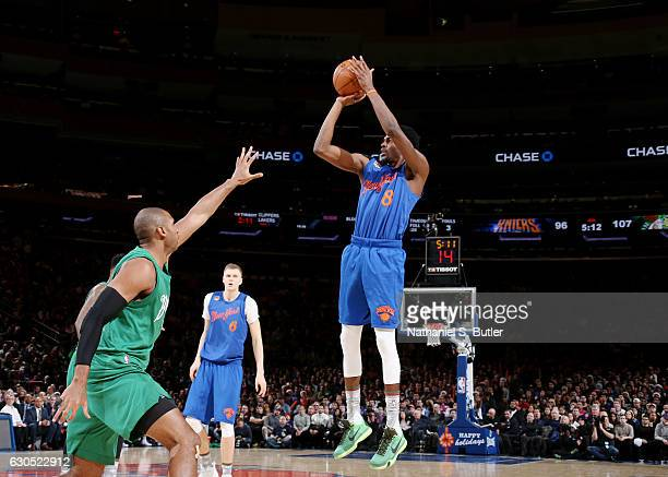 Justin Holiday of the New York Knicks shoots during a game against the Boston Celtics on December 25 2016 at Madison Square Garden in New York New...
