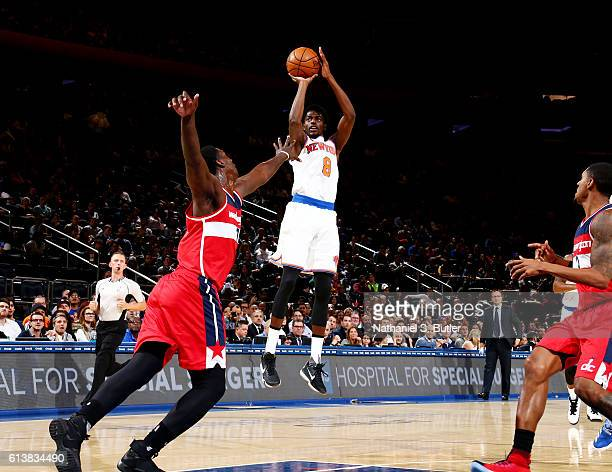 Justin Holiday of the New York Knicks shoots the ball against the Washington Wizards during a preseason game on October 10 2016 at Madison Square...