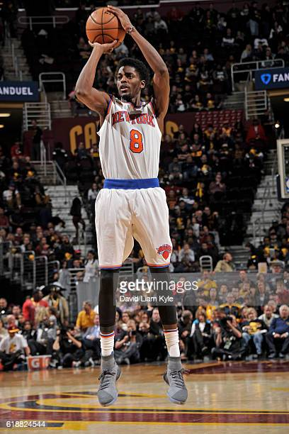 Justin Holiday of the New York Knicks shoots the ball against the Cleveland Cavaliers on October 25 2016 at Quicken Loans Arena in Cleveland Ohio...