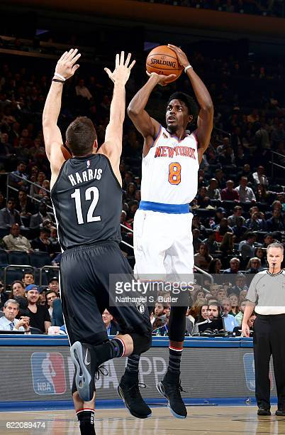 Justin Holiday of the New York Knicks shoots the ball against the Brooklyn Nets on November 9 2016 at Madison Square Garden in New York City New York...