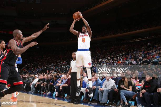 Justin Holiday of the New York Knicks shoots the ball during a game against the Toronto Raptors on April 9 2017 at Madison Square Garden in New York...