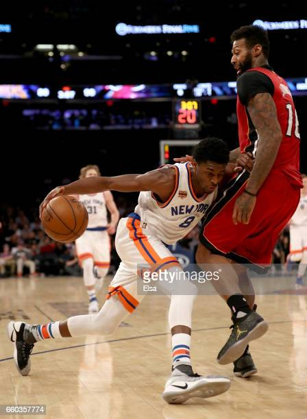 Justin Holiday of the New York Knicks tries to get past James Johnson of the Miami Heat at Madison Square Garden on March 29 2017 in New York City...