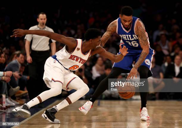 Justin Holiday of the New York Knicks tries to steal as Shawn Long of the Philadelphia 76ers takes the ball in the second half at Madison Square...