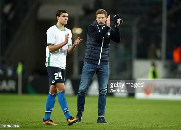 Justin Hoogma and Julian Nagelsmann of 1899 Hoffenheim applaud the fans following the UEFA Europa League group C match between 1899 Hoffenheim and...