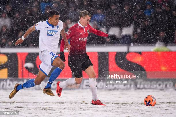 Justin Hoogma of 1899 Hoffenheim and Oliver Sorg of Hannover 96 battle for the ball during the Bundesliga match between Hannover 96 and TSG 1899...