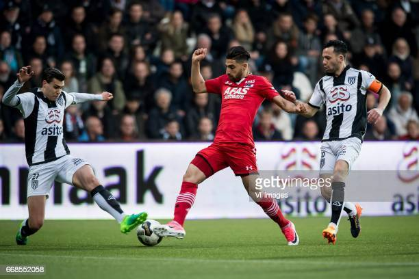 Justin Hoogma of Heracles Almelo Alireza Jahanbakhsh of AZ Thomas Bruns of Heracles Almeloduring the Dutch Eredivisie match between Heracles Almelo...