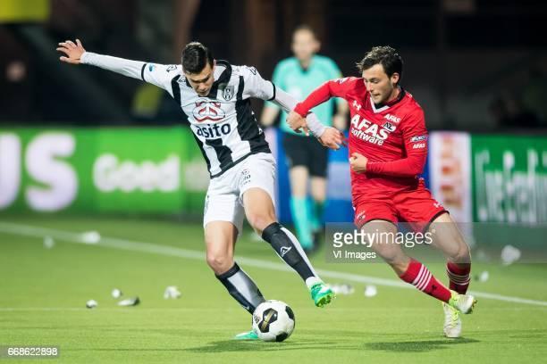 Justin Hoogma of Heracles Almelo Joris van Overeem of AZduring the Dutch Eredivisie match between Heracles Almelo and AZ Alkmaar at Polman stadium on...