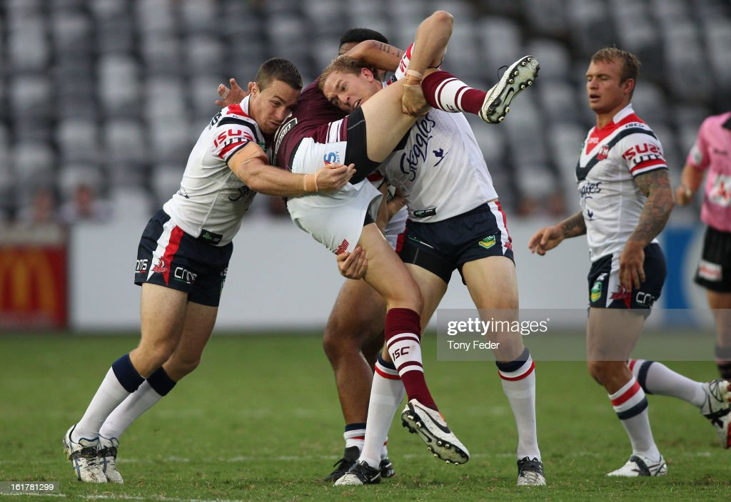 Justin Horo of the Sea Eagles is dumped by the Roosters defence during the NRL trial match between the Manly Sea Eagles and the Sydney Roosters at Bluetongue Stadium on February 16, 2013 in Gosford, Australia.