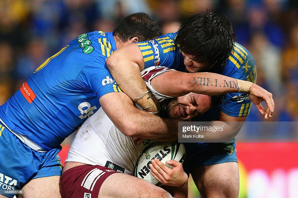 Justin Horo of the Sea Eagles is tackled during the round 24 NRL match between the Parramatta Eels and the Manly Sea Eagles at Pirtek Stadium on August 22, 2014 in Sydney, Australia.