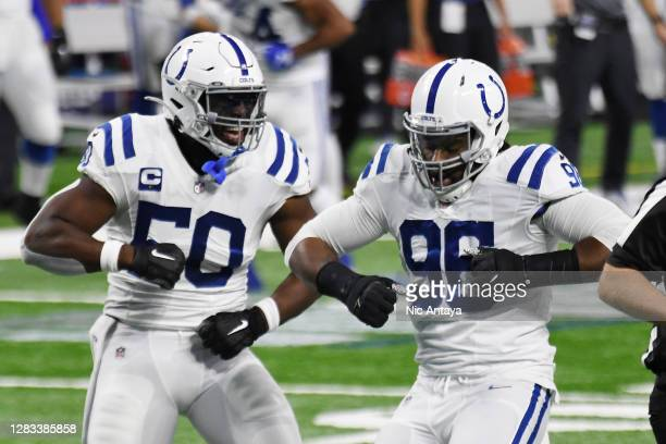 Justin Houston and Denico Autry of the Indianapolis Colts celebrate after a sack on third down against the Detroit Lions during the second quarter at...