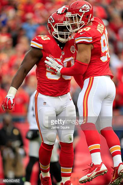 Justin Houston and Josh Mauga of the Kansas City Chiefs celebrate stopping the Oakland Raiders on third down in the first quarter at Arrowhead...