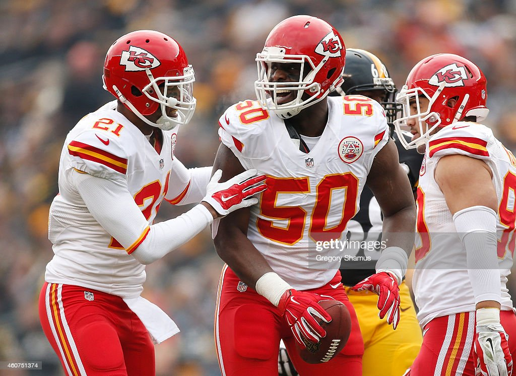Justin Houston #50 celebrates his fumble recovery with Sean Smith #21of the Kansas City Chiefs during the second quarter against the Pittsburgh Steelers at Heinz Field on December 21, 2014 in Pittsburgh, Pennsylvania.