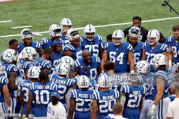 Justin Houston of the Indianapolis Colts talks to his team before the start of the in the game against the New York Jets at Lucas Oil Stadium on...