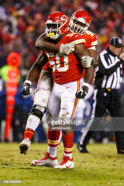 Justin Houston of the Kansas City Chiefs celebrates a sack against the Indianapolis Colts with teammate Chris Jones during the third quarter of the...