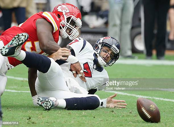 Justin Houston of the Kansas City Chiefs forces a fumble on Brian Hoyer of the Houston Texans during the first half at NRG Stadium on September 13...