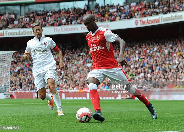 Justin Hoyte of Arsenal Legends closed down by Alessandro Costacurta of Milan during the Arsenal Foundation Charity match between Arsenal Legends and...