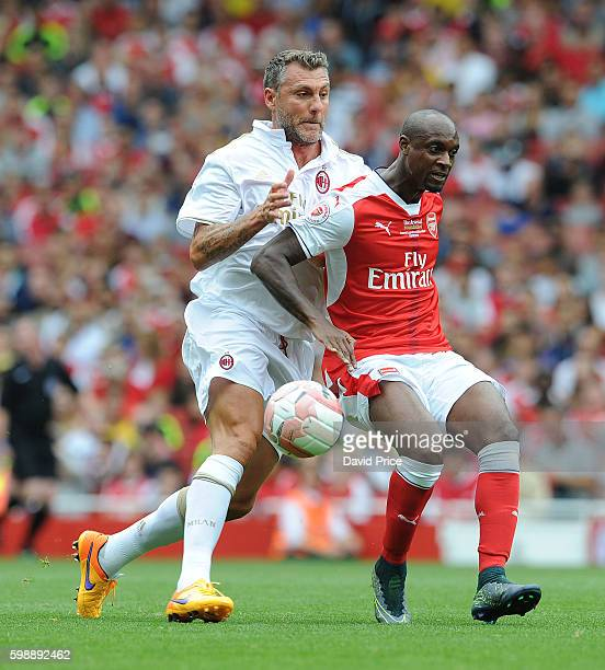 Justin Hoyte of Arsenal Legends holds off Christian Vieri of Milan during the Arsenal Foundation Charity match between Arsenal Legends and Milan...