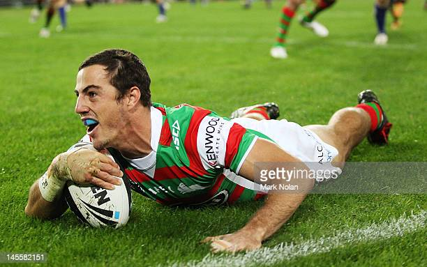 Justin Hunt of the Rabbitohs scores during the round 13 NRL match between the Canterbury Bulldogs and the South Sydney Rabbitohs at ANZ Stadium on...