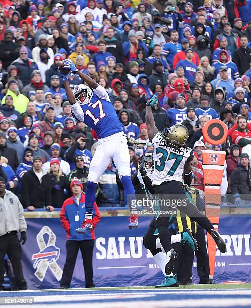 Justin Hunter of the Buffalo Bills catches a touchdown in the end zone in the fourth quarter during NFL game action as Johnathan Cyprien of the...