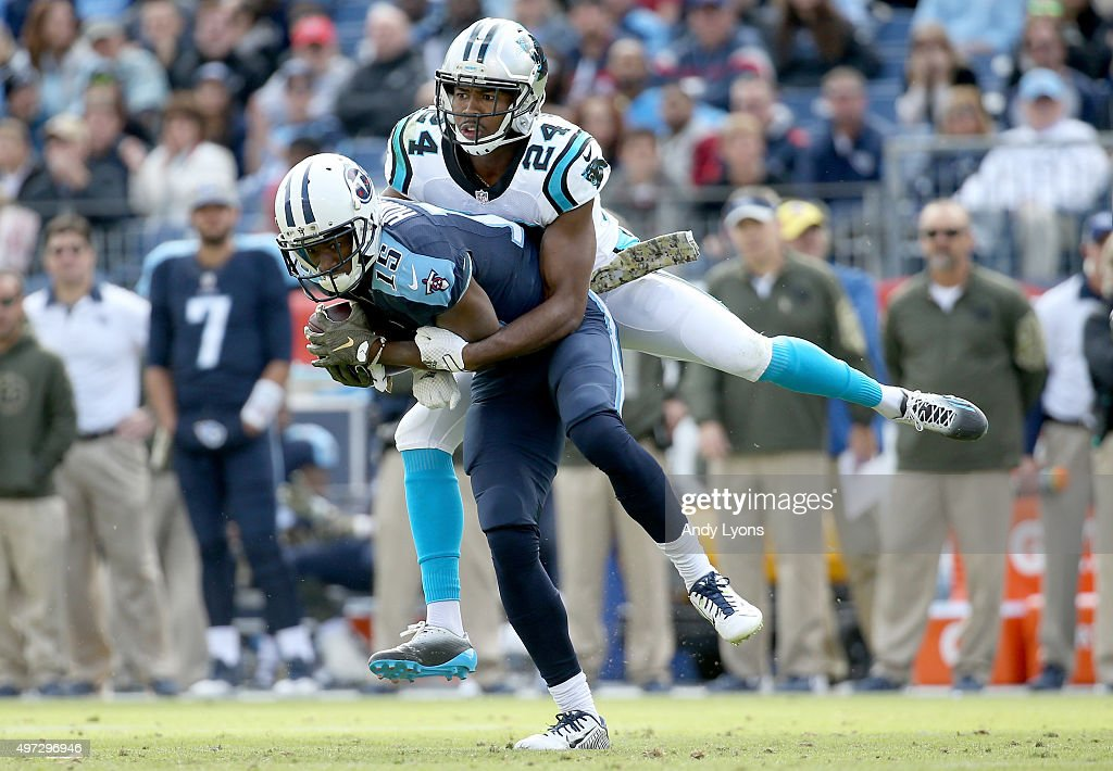 Justin Hunter #15 of the Tennessee Titans is tackled by Josh Norman #24 of the Carolina Panthers during the second half at LP Field on November 15, 2015 in Nashville, Tennessee.