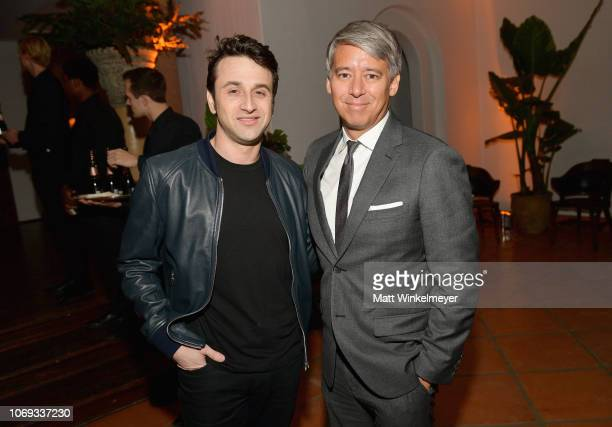 Justin Hurwitz and Tom Cross attend the 2018 GQ Men of the Year Party at a private residence on December 6 2018 in Beverly Hills California