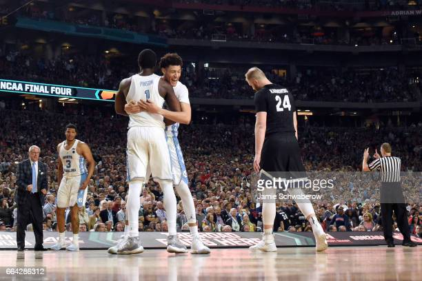 Justin Jackson and Theo Pinson of the North Carolina Tar Heels embrace each other during the 2017 NCAA Men's Final Four National Championship game...