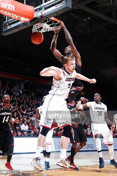 Justin Jackson of the Cincinnati Bearcats dunks the ball against Niels Giffey of the Connecticut Huskies during the game at Fifth Third Arena on...