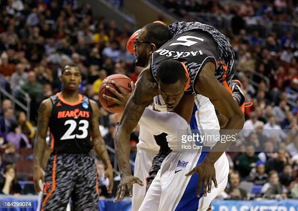 Justin Jackson of the Cincinnati Bearcats fouls Gregory Echenique of the Creighton Bluejays in the second half during the second round of the 2013...