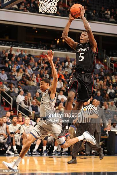 Justin Jackson of the Cincinnati Bearcats goes for a jam during a college basketball game against the Georgetown Hoyas on January 9, 2012 at the...