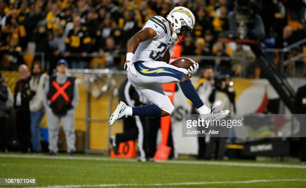 Justin Jackson of the Los Angeles Chargers jumps into the end zone for a 18 yard touchdown in the fourth quarter during the game against the...